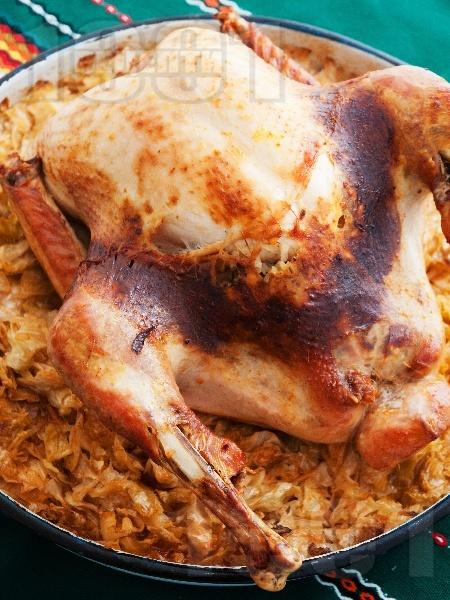 Пълнена печена Коледна пуйка с кисело зеле и ориз на фурна - снимка на рецептата